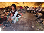 In the Chang Tang region of Eastern Ladakh, a Tibetan woman takes care of her granddaughter as she naps. <em>© Paula Bronstein</em>