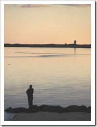 11.2011 sun setting lighthouse fisherman west end provincetown