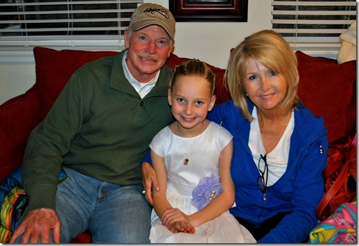 Halle with Grandma and Grandpa Banks. She's wearing the special necklace they gave her at her baptism