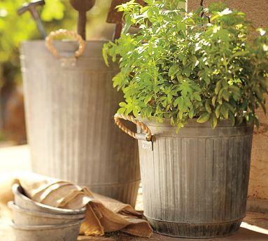 These buckets can be used as storage, but I think they look best as planters. They're charming in any backyard. (potterybarn.com)