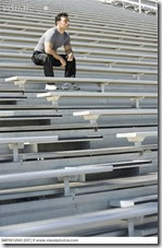 man_sitting_in_bleachers_SMP0012543