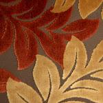 Tkanina obiciowa, trudnopalna. Pluszowa. Motyw roślinny - liście. Brązowa.
