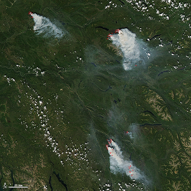 On 14 July 2013, NASA's Aqua satellite captured this image of three large wildfires burning in the Yukon territory of western Canada. Red outlines indicate hot spots where Aqua detected unusually warm surface temperatures associated with fire. The image is centered at 136° West longitude and 62.5° North latitude. Photo: Jeff Schmaltz / NASA GSFC