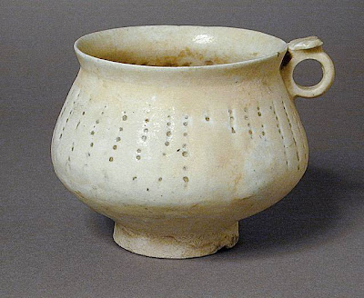 Tankard Iran Tankard, late 12th or 13th century Ceramic; Vessel, Fritware, pierced, glazed, 4 3/16 x 3 5/16 in. (10.7 x 8.4 cm) The Nasli M. Heeramaneck Collection, gift of Joan Palevsky (M.73.5.146) Art of the Middle East: Islamic Department.