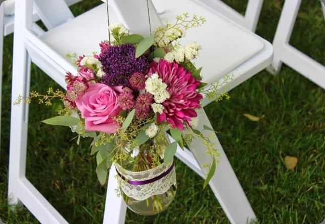 pew end1016680_521463797918875_1871404428_n sophisticated floral designs