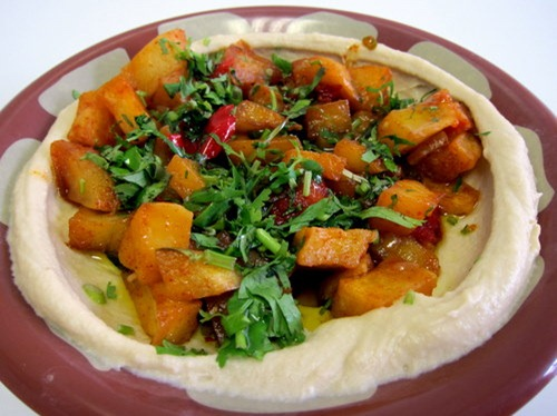 MR FALAFEL's Combo - A bowl of Hommous topped with a layer of spicy potatoes, garnished with fresh coriander leaves and served with warm bread