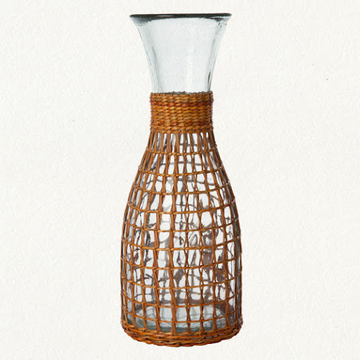 The wicker wrap around this pitcher gives it a unique style. It would look fabulous filled with water or wine! (shopterrain.com)