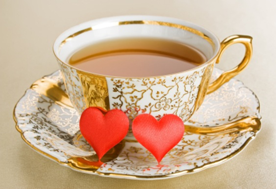 gold trim teacup with hearts