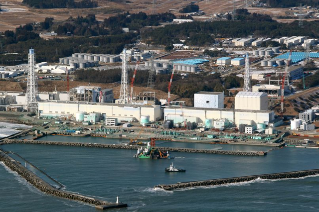 Aerial view of the Fukushima Dai-ichi nuclear plant, nearly a year after the meltdowns. Workers begin pouring cement onto the seabed at the Fukushima No. 1 nuclear power plant on 28 February 2012. Eiji Hori
