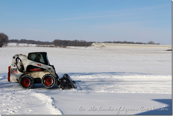 plowing snow on farm