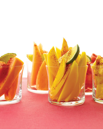 A sprinkle of chili brightens the sweet flavor of sliced mangoes. (marthastewart.com)