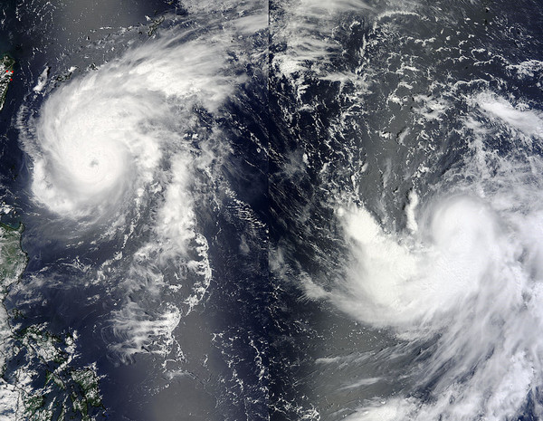This split image shows Typhoon Tembin (right) and Typhoon Bolaven (left) on 20 August 2012. NASA