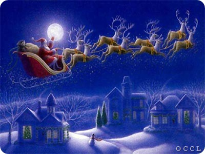 Santa_claus_flying_beside_moon_over_hosues_in_night_snow_reindeer_Christmas_gifts_photo