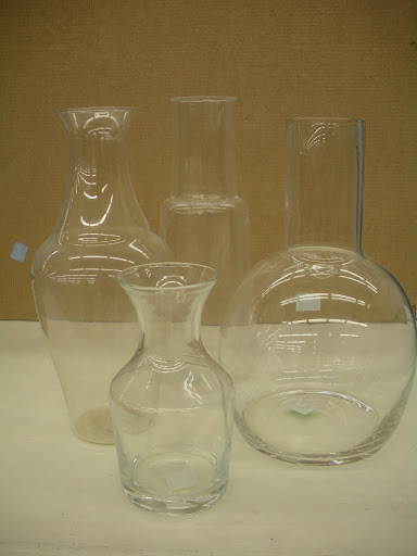 An assortment of glass vases and carafes in great condition.