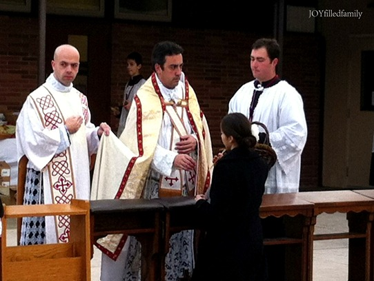 E receiving blessed candle 2.2.13 v2