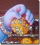 Krishna taking a laddu
