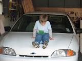 Sitting on the car like Daddy