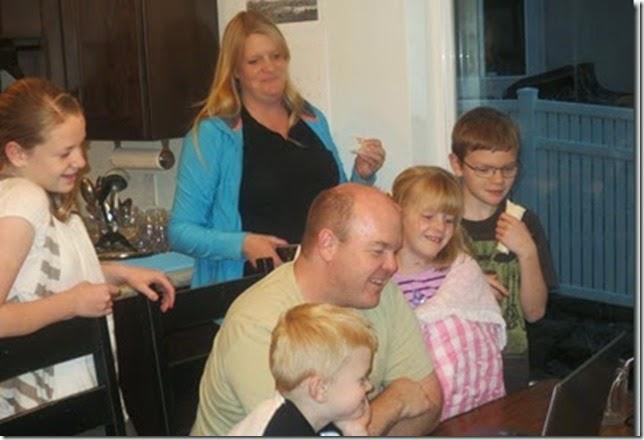 family watching laptop