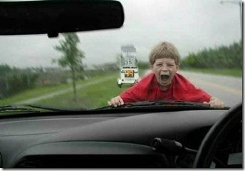 child on car