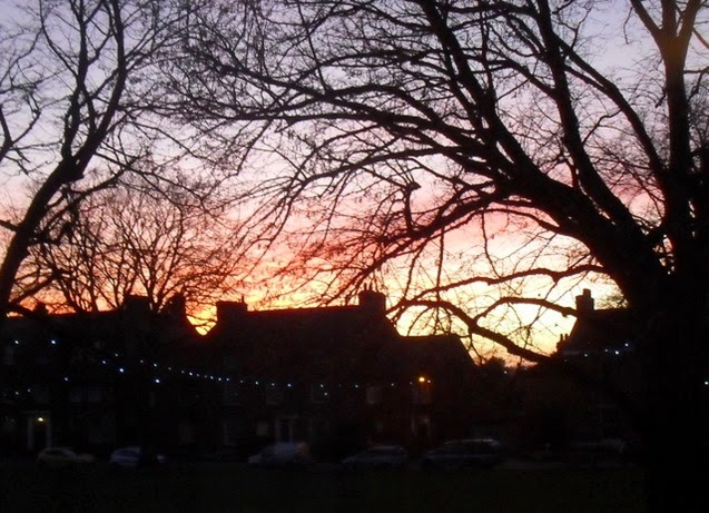 rosy sunset and strings of lights - The Buttlands, Wells
