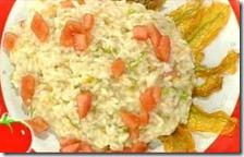 Risotto con fiori di zucca, canestrato e dadolata di pomodori