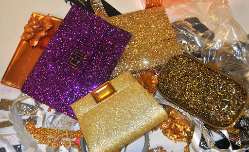 Holy shine: Three glittering clutches from Anya Hindmarch (anyahindmarch.com) and the bottom gold number is from Kara Ross (kararossny.com).