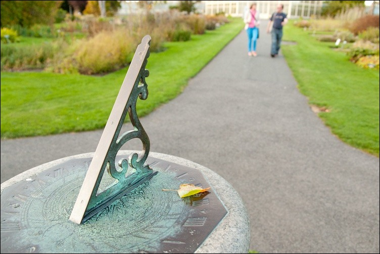 30/09/2011 -- DCU -- a sundial decorated with a deciduous leaf  on an alley leading to the main glasshouse in National Botanic Garden, Glasnevin Dublin. Photograph: Aleksander Szojda / DCU