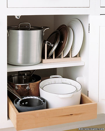 Keep lids and pans in order with this trick. Place a wooden peg rack in a cupboard, and line up the lids vertically between the pegs.