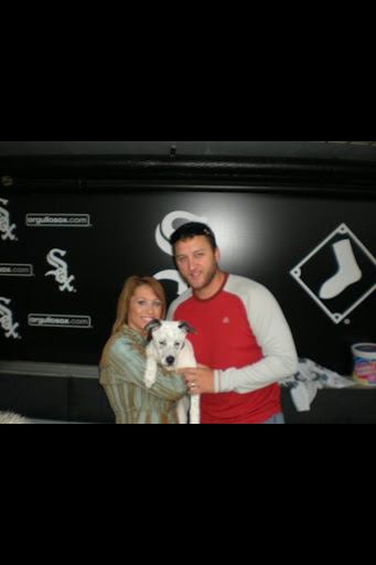 Jamie and Mark with Sammy, a featured adoptable dog, at the first Sox For Strays event at U.S. Cellular Field.