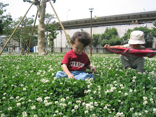 Eidan in the grass at the World City Tower's park