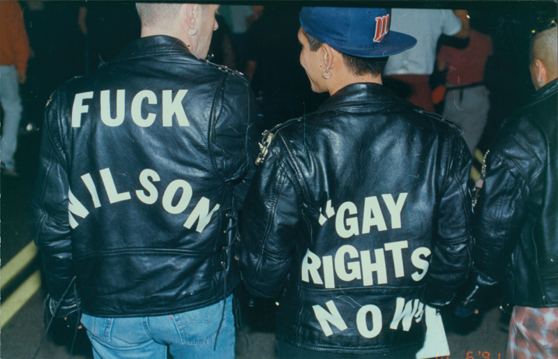 "Two men with leather jackets reading ""Fuck Wilson"" and ""Gay Rights Now"" in Silver Lake, protesting against California Governor Pete Wilson. October 6, 1991."