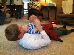 Joe & Sam wrestling around in the living room - Sam thinks he has total control over his tall uncle.