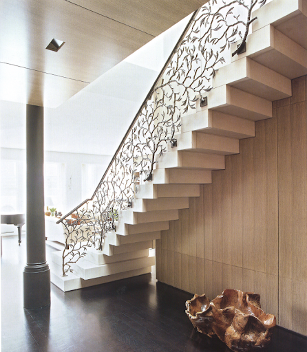 This staircase features an artfully-designed cast-bronze railing. Artist Bill Sullivan contributed to the design.