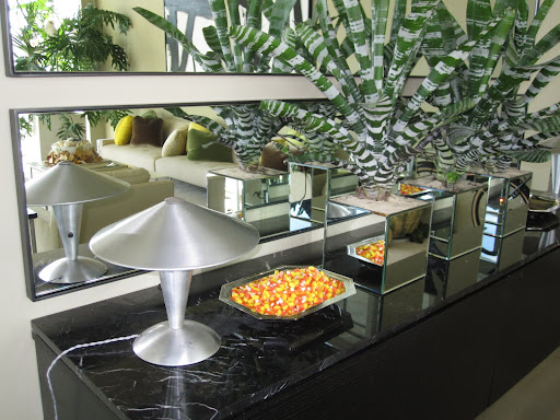 I placed candy corn in small silver bowls around the living room for guests to enjoy.