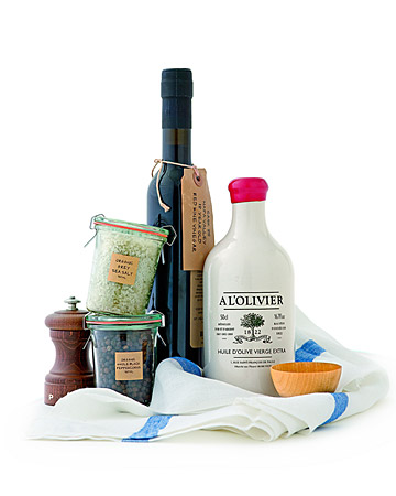 This basics kit will be appreciate by the experienced chefs or the less-experienced cooks in your life. Our food editors swear by these finishing touches. Extra-virgin olive oil, by A l'Olivier, Napa Valley red wine vinegar, organic fleur de sel, and organic whole peppercorns from St. Helena Olive Oil Company, beechwood pepper mill, striped towel by Cote Bastide, and a wooden salt bowl.