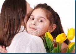 13281846-little-daughter-hug-her-mom-with-bouquet-of-yellow-tulips