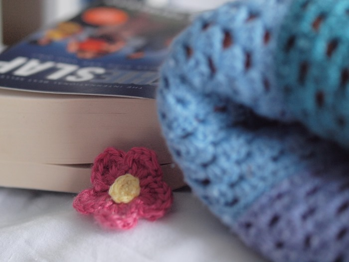 in waiting with crocheted flower bookmark