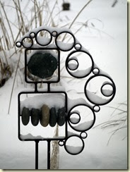 Garden sculpture with snow