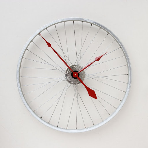 The bike wheel translates well into a clock. (Handmade Geekery on etsy.com)