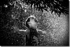 boy-playing-in-rain