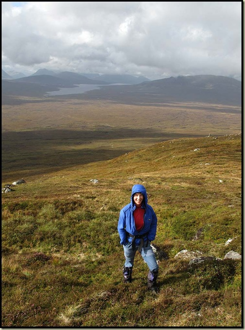 Sue on the slopes of Carn Dearg, with the Blackwater Reservoir behind