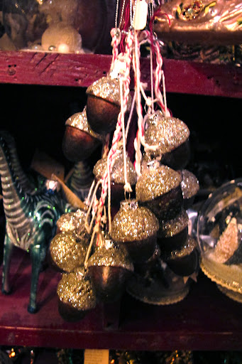 A cluster of glittery acorns; these would be great hung from a doorknob.