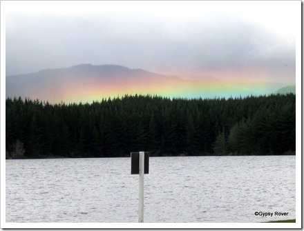 A strange rainbow over the forest behind Lake Maraetai.