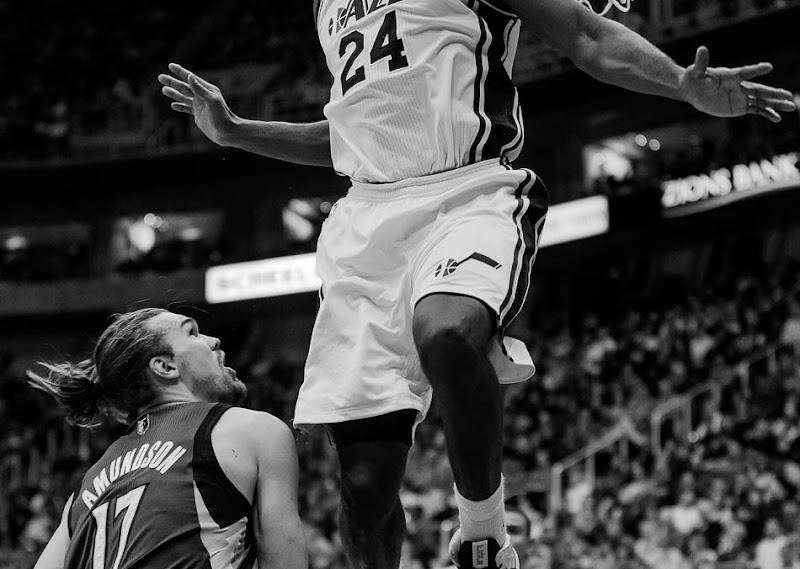 Utah Jazz power forward Paul Millsap \(24\) flies high over Minnesota's Lou Admundson as the Utah Jazz host the Minnesota Timberwolves, NBA basketball Wednesday January 2, 2013 in Salt Lake City