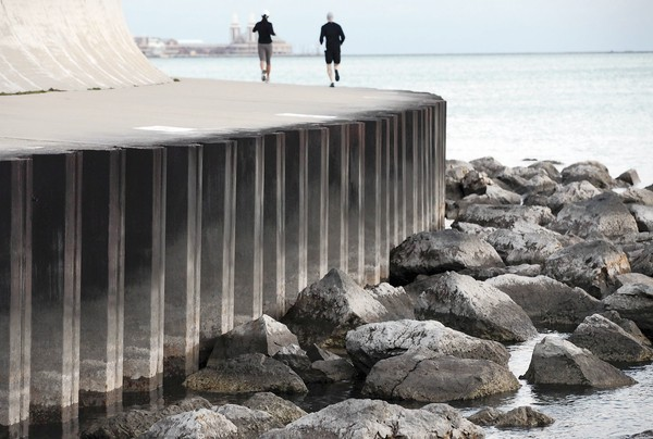 As Lake Michigan's water levels have droppedduring summer 2012, more than recreational fishers have taken note. Near the Shedd Aquarium, submerged rocks have already surfaced — new fixtures along the widening shores. Heather Charles / Chicago Tribune