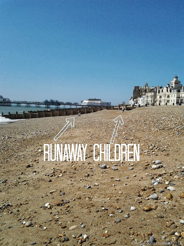 runaway children, beach, eastbourne, pier