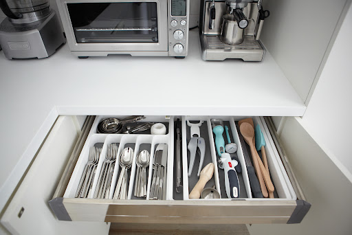 In my kitchen, I use expandable organizers to store my cooking tools. They're great because they adjust to fit each drawer perfectly.