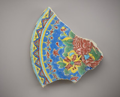 Fragmentary tile | Origin:  Shiraz?,  Iran | Period: 18th century | Details:  Not Available | Type: Cuerda seco earthenware | Size: H: 23.9  W: 26.1  cm | Museum Code: F1908.110 | Photograph and description taken from Freer and the Sackler (Smithsonian) Museums.
