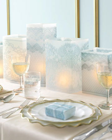 To make square luminarias beautiful enough to be centerpieces, simply magnified a lace pattern. (marthastewartweddings.com)