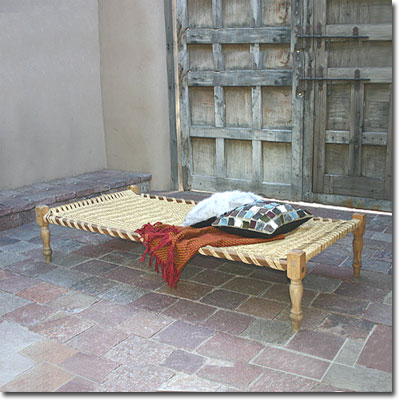 Anyone would be happy taking a siesta outdoors with this great rope day bed. (pfeiferstudio.com)
